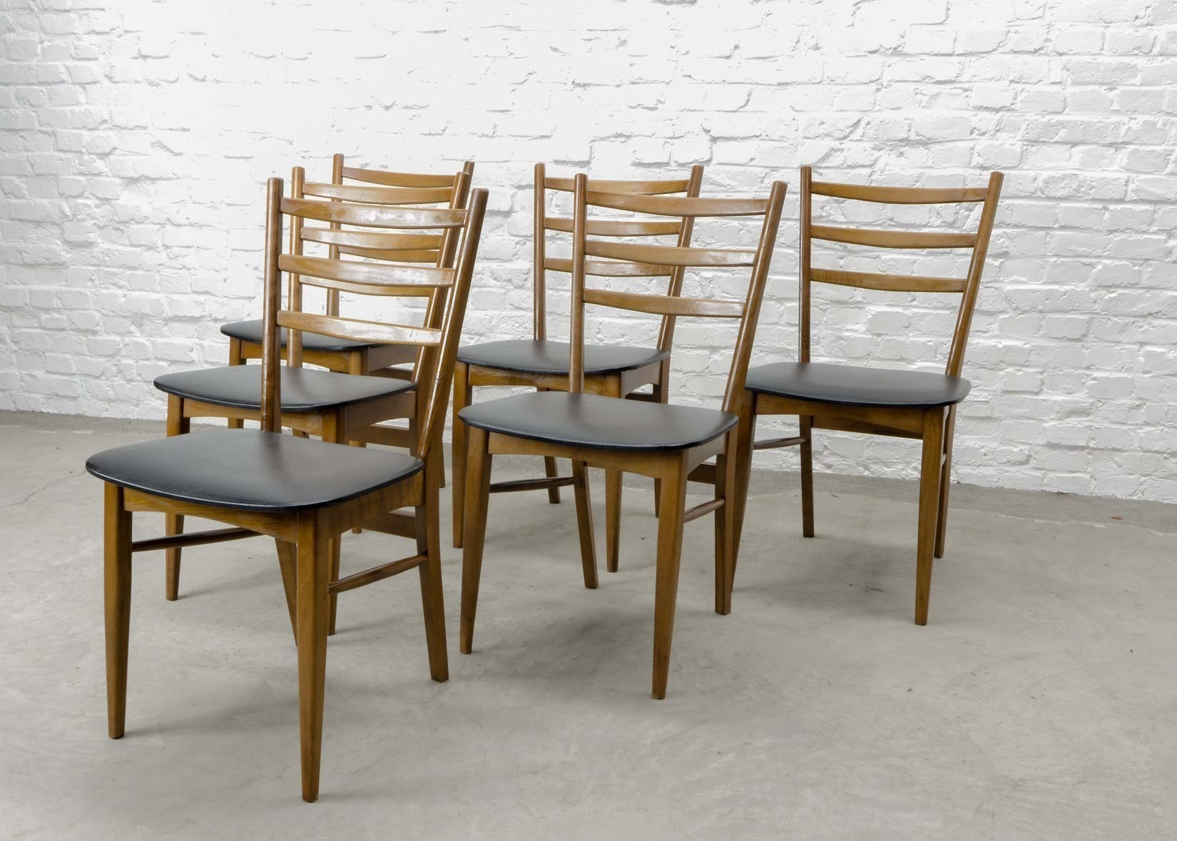 Set Of Six Mid Century Design Solid Wood Ladder Dining Chairs With Black Leatherette Seating 1960s