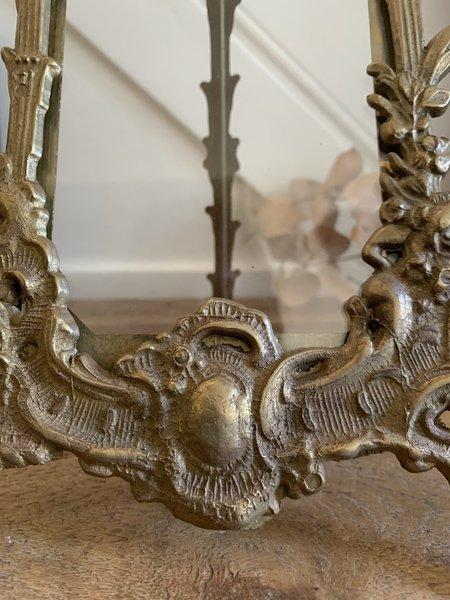 Beautiful vintage brass photo frame with ornate adjustable frame.