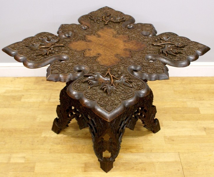 A Profusely Carved Indian Hardwood Table